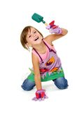 Girl in garden clothes with garden scoop Stock Photo