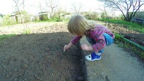 Girl in garden stock video footage