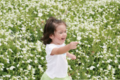 Girl in a garden of flowers Royalty Free Stock Image