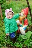Girl-and-garden-gnome stock photography