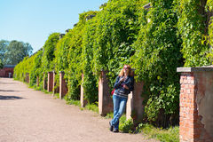 The girl in a garden in Peterhof Royalty Free Stock Photography
