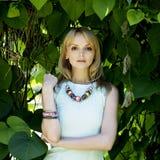 Girl in the garden. Girl posing in the garden Royalty Free Stock Images