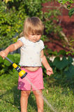 Girl in garden are pouring Royalty Free Stock Image