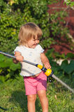 Girl in garden are pouring Royalty Free Stock Photo