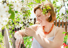 Girl is in the garden spring. Royalty Free Stock Photo