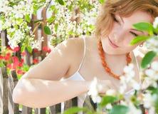 Girl is in the garden spring. stock photos