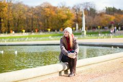 Girl in the Gardens of Luxembourg of Paris Stock Photos