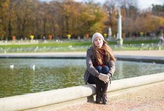 Girl in the Gardens of Luxembourg of Paris Stock Photo