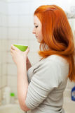Girl gargles her throat in bathroom royalty free stock photos