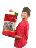 Girl in garrison cap with christmas gifts Stock Image