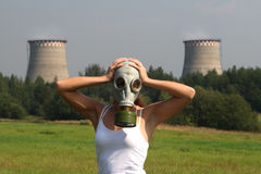 Girl in a gas mask. And smoke pipes Stock Photo