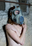 Girl with gas mask. Topless girl a military gas mask Stock Photo