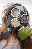 Girl in a gas mask. Bad ecology concept. Gray gradient background Royalty Free Stock Photography