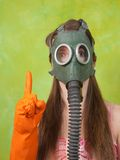Girl in gas mask pointing attention Stock Image