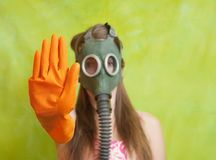 Girl in gas mask pointing stop Royalty Free Stock Photography