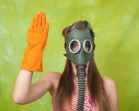 Girl in gas mask pointing STOP Stock Photo