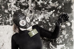 The girl in a gas mask. The threat of ecology. The idea of ​​the need to preserve the environment Stock Images