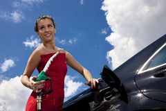 Girl at gas station Royalty Free Stock Photo