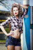 Girl at gas station Stock Images
