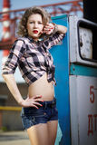 Girl at gas station Royalty Free Stock Photography
