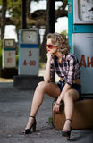 Girl at gas station Royalty Free Stock Photo