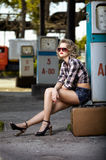 Girl at gas station Stock Photography