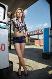 Girl at gas station Royalty Free Stock Images
