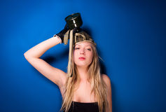 Girl in gasmask. Against blue wall Stock Photo