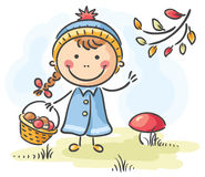 Girl gathering mushrooms in the forest on an autumn day. Little girl gathering mushrooms in the forest on an autumn day Royalty Free Stock Photos