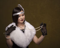 Girl in gatsby style Royalty Free Stock Photography