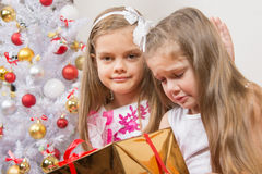The girl gave wrong gift, another girl comforting her Stock Images