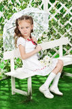 Girl in the gazebo on the bench in the garden Stock Images