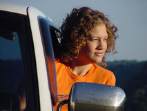 Girl gazing. Girl looking out truck window Royalty Free Stock Photography