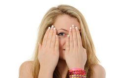 Girl is gazing through her fingers Stock Photography