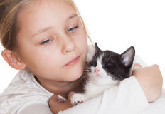 girl gently hugs kitten Royalty Free Stock Photography