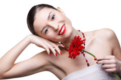 Girl with gerbera flower Royalty Free Stock Photo