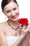 Girl with gerbera flower Stock Images
