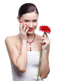 Girl with gerbera flower Royalty Free Stock Image