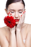 Girl with gerbera flower Stock Image