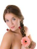 Girl with gerbera flower Stock Photos