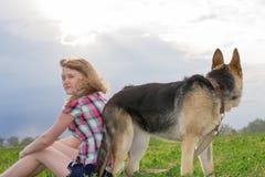 Girl with a German Shepherd Stock Photography