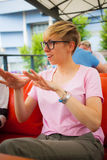 The girl is gesticulating. The girl speaks and actively gestures with her hands. A woman is showing something with her fingers. The blonde talks and explains Stock Photos