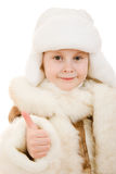 Girl in a gesture of warm clothing shows okay Stock Photography