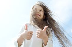 Girl gestures shows. That everything is fine in the sky Royalty Free Stock Photos