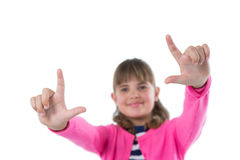 Girl gesturing against white background Royalty Free Stock Photo