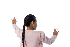 Girl gesturing against white background. Rear view of girl gesturing against white background Stock Photo