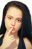 Girl Gesturing For Being Quiet Royalty Free Stock Image