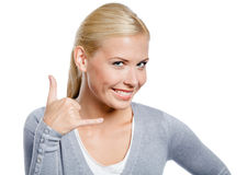 Girl gesturing phone call Royalty Free Stock Photography