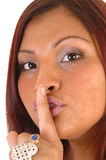 Girl gesturing quiet. A pretty Hispanics' woman in a closeup head shoot signing by quiet Royalty Free Stock Photo
