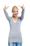 Girl gesturing rock sign Stock Images
